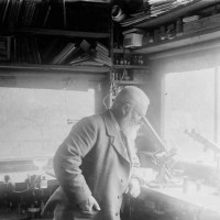 Thomas Forrester with microscopes in his workshop, Wharfe Street, Oamaru